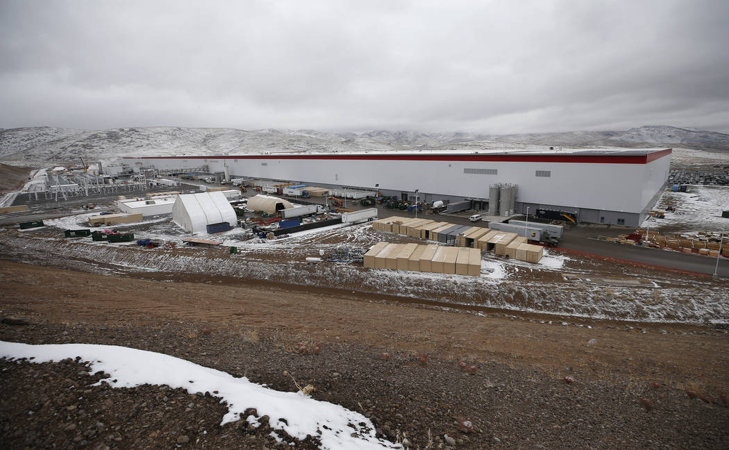 The Tesla Gigafactory, east of Reno, Nev., seen on Tuesday, Dec. 4, 2018, employs more than 7,000 employees. The gigafactory currently sits on a 1.9 million square foot footprint and boosts 5.5 mi ...