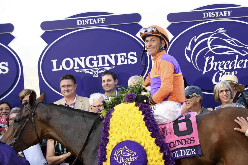 Jockey Gary Stevens, on Beholder, smiles after winning the Longines Breeders' Cup Distaff, Friday, Nov. 4, 2016,at Santa Anita Park in Arcadia, California. (Diane Bondareff/Invision for Longines/A ...