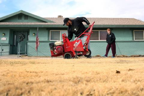 Mary Kiosowski Lewis, right, watches as Pacas Rivera of North West Landscape uses sod removal to remove old lawn from her front yard on Monday, Dec. 10, 2018. Bizuayehu Tesfaye Las Vegas Review-Jo ...