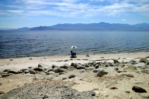 A man fishes for tilapia along the receding banks of the Salton Sea near Bombay Beach, Calif., April 30, 2015. (Gregory Bull/AP, File)