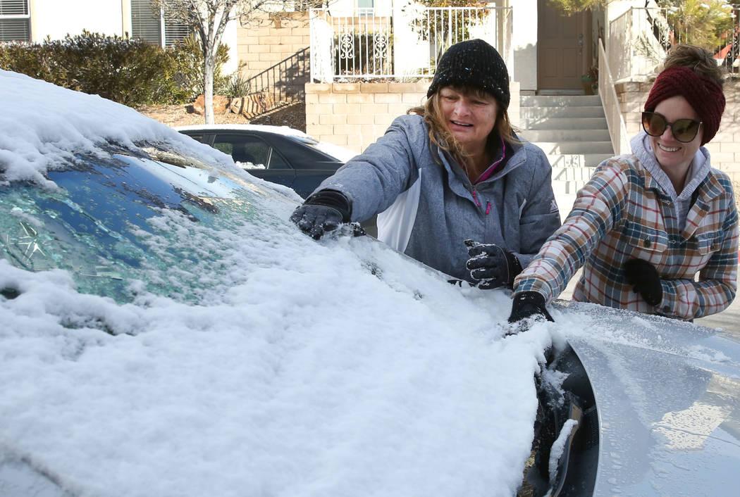 Rhonda Davis, left, of San Diego and her daughter Meagan Hoyt of Las Vegas remove snow from Davis' car in Summerlin on Monday, Feb. 18, 2019, in Las Vegas. (Bizuayehu Tesfaye/Las Vegas Review-Jour ...