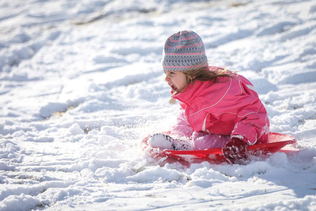 Lila Petronzi, 4, sleds down a snow-covered hill at Fox Hill Park in the Summerlin area of Las Vegas, Monday, Feb. 18, 2019. (Caroline Brehman/Las Vegas Review-Journal) @carolinebrehman