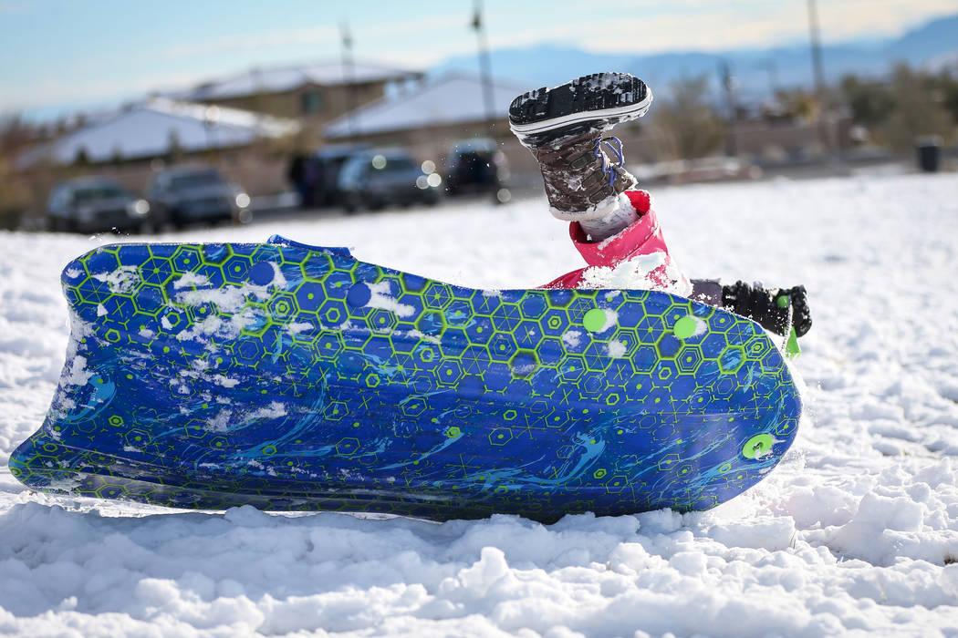 Nora Petronzi, 8, falls over in her sled at Fox Hill Park in the Summerlin area of Las Vegas, Monday, Feb. 18, 2019. (Caroline Brehman/Las Vegas Review-Journal) @carolinebrehman