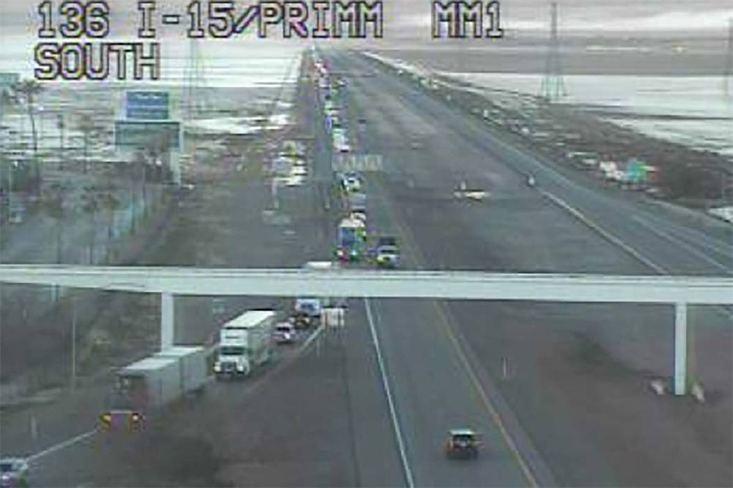 Traffic on northbound Interstate 15 is being diverted off the highway because of icy road conditions, Monday, Feb. 18, 2019. The Nevada Highway Patrol has closed I-15 in both directions between La ...