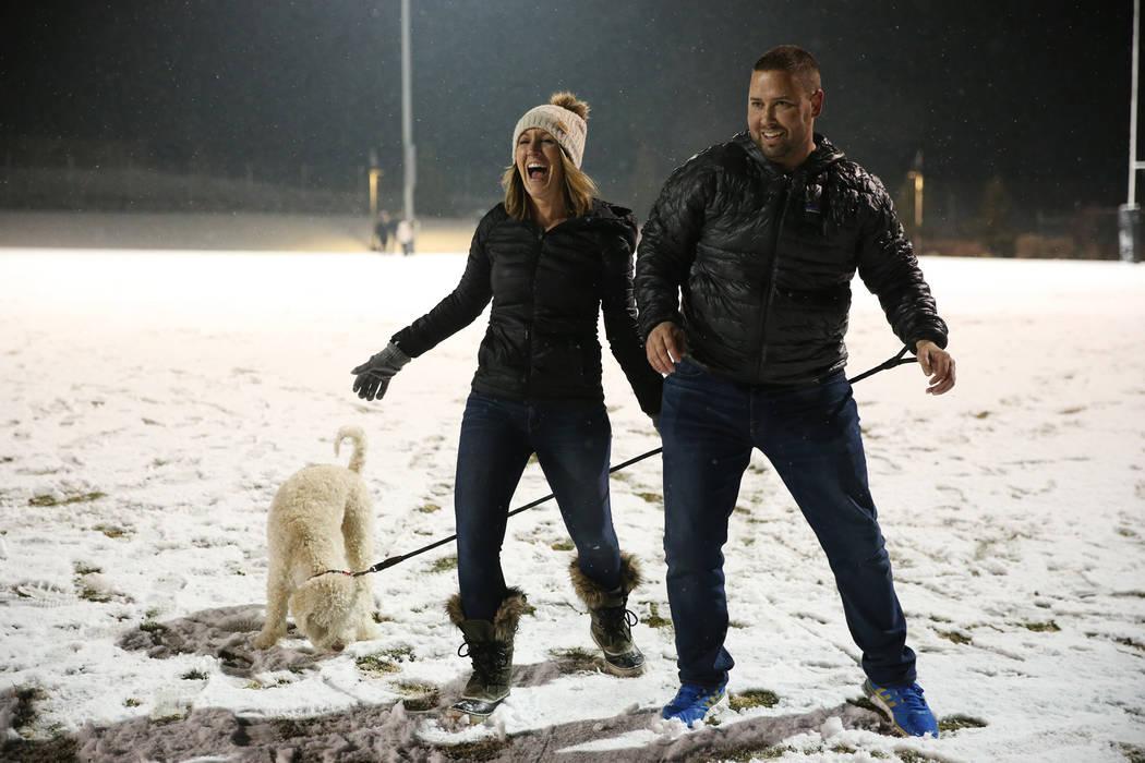 Andrea Mott, left, and her husband Joey, with their dog Bo, of Las Vegas, play at the Skye Canyon Park in Las Vegas, Wednesday, Feb. 20, 2019. (Erik Verduzco/Las Vegas Review-Journal) @Erik_Verduzco