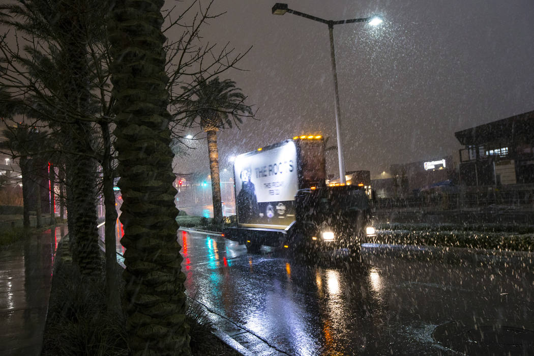 Snow falls down as a truck drives around Downtown Summerlin in Las Vegas on Wednesday, Feb. 20, 2019. (Chase Stevens/Las Vegas Review-Journal) @csstevensphoto