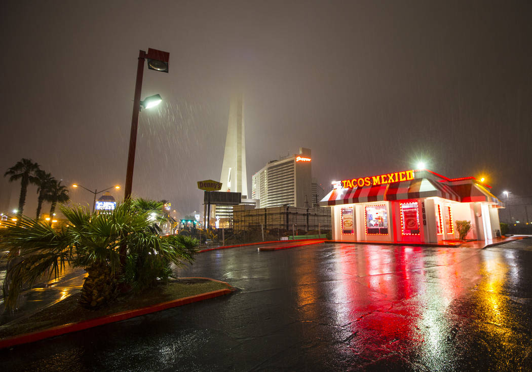 The Strat is obscured in the background as snow falls in Las Vegas in the parking lot of a Tacos Mexico restaurant on Wednesday, Feb. 20, 2019. (Chase Stevens/Las Vegas Review-Journal) @csstevensphoto
