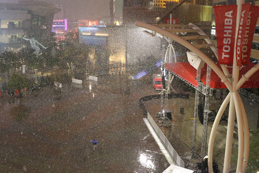 Snow falls outside of T-Mobile Arena in the Toshiba Plaza near The Strip in Las Vegas, Wednesday, Feb. 20, 2019 ]. (Heidi Fang /Las Vegas Review-Journal) @HeidiFang