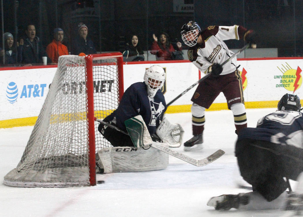 Faith Lutheran's Noah McAnallen (11) scores a goal against Utah's goaltender Landon Palmer, left, during the second period of a hockey game at the City National Arena in Las Vegas, Saturday, Dec. ...