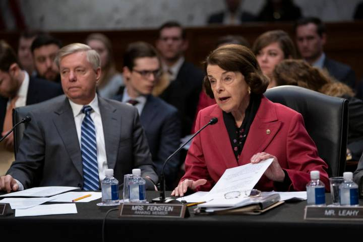 Senate Judiciary Committee Chairman Lindsey Graham, R-S.C., listens at left as Sen. Dianne Feinstein, D-Calif., the ranking member, objects to advancing the nomination of Bill Barr to be attorney ...