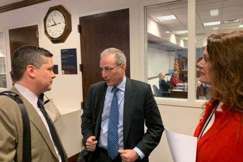Ben Lieberman, center, an advocate for tougher distracted driving laws, speaks to Nevada Assemblyman Steve Yeager, D-Las Vegas, following a bill hearing Friday, March 1, 2019. Assemblywoman Michel ...