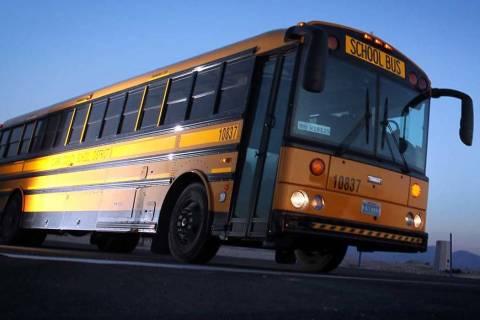 A Clark County School District bus leaves the Wallace Bus Yard in Henderson. (Jeff Scheid/Las V ...
