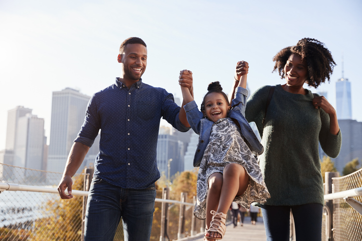Young family taking a walk on footbridge, close up