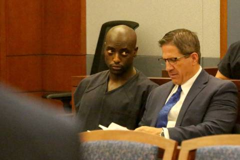 Former NFL player Cierre Wood, left, who along with his girlfriend, is charged with first-degre ...