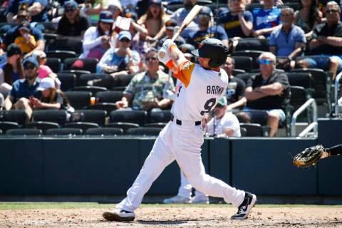Seth Brown (9) of the Las Vegas Aviators swings for a hit during a regular season game between ...