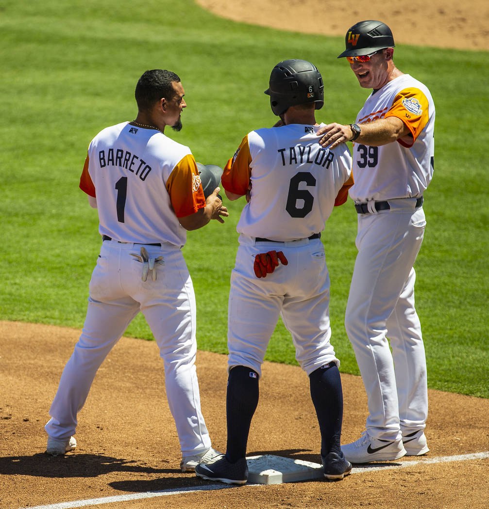 (From right) Aviators manager Fran Riordan (39) shares a laugh with base runners Beau Taylor (6 ...