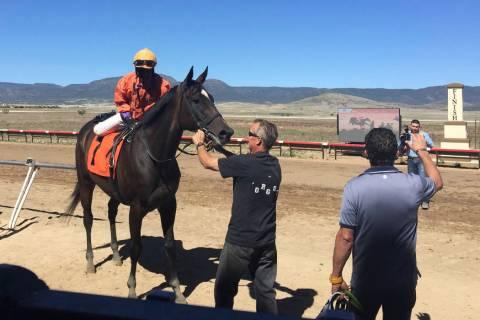 Carl Williams rides Sashaying Sis in the winner's enclosure at Arizona Downs in Prescott Valley ...