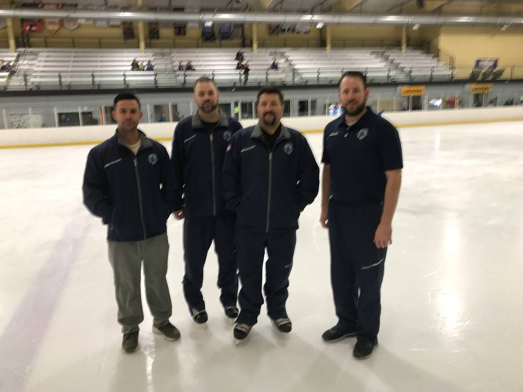 Four of the volunteer team coaches are on ice at the Sobe Ice Arena; from left are Alex Granda, ...