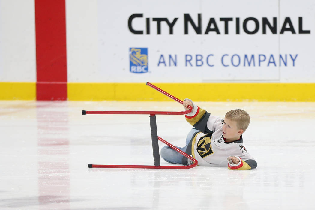 Weston Gregory, 6, takes a fall during the Jake Kielb's Hockey Foundation open skate session at ...