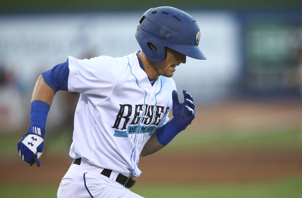 """Las Vegas 51s' Gavin Cecchini runs for first base during the debut of the """"Reyes de Plata"""" (Sil ..."""