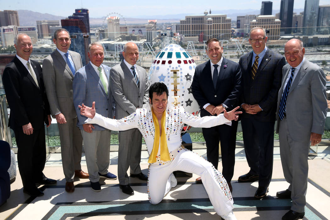 Elvis impersonator Harry Shahoian poses with, from left, Steve Hill, CEO and president of the L ...