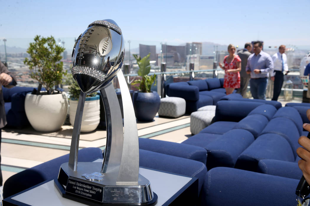 A trophy during an announcement for the Mitsubishi Las Vegas Bowl during a news conference in t ...