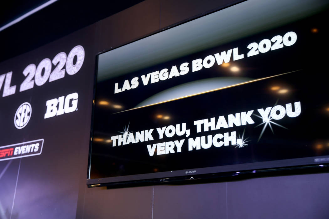 A screen during an announcement for the Mitsubishi Las Vegas Bowl during a news conference in t ...