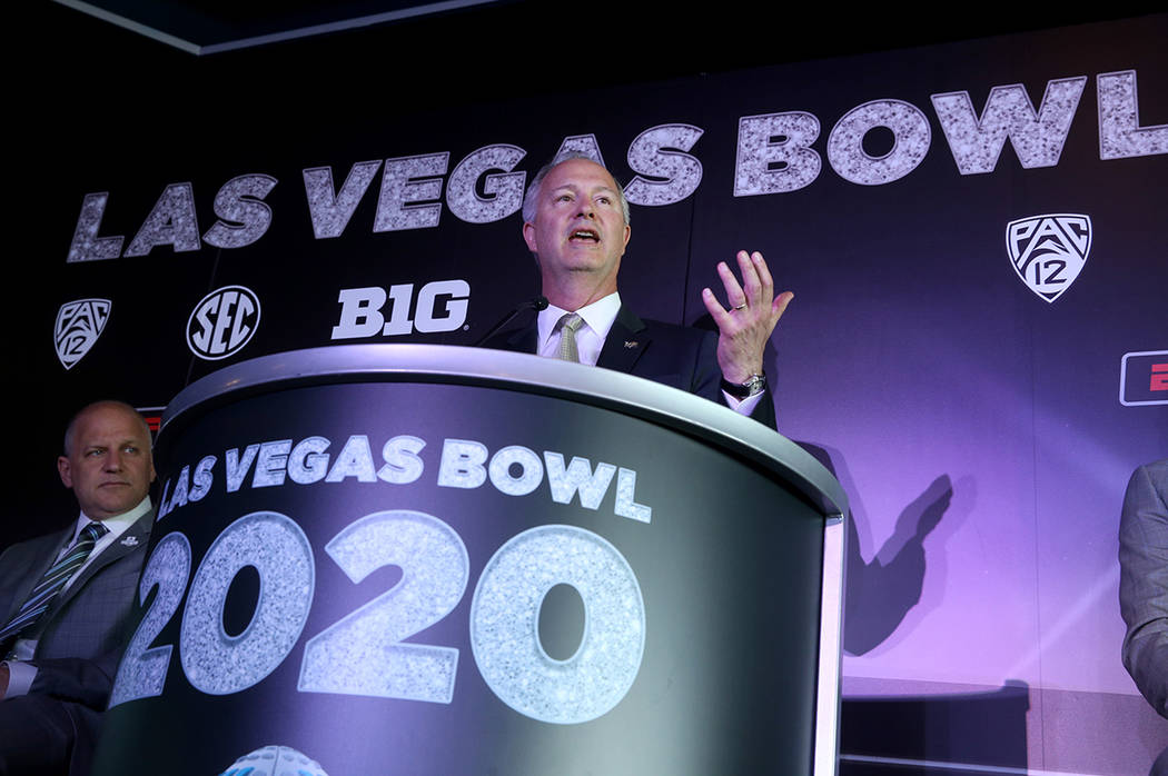 Steve Hill, CEO and president of the Las Vegas Convention and Visitors Authority, right, and Ra ...