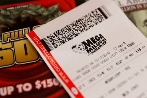 A Mega Millions lottery ticket rests on a shop counter. (AP Photo/John Minchillo)