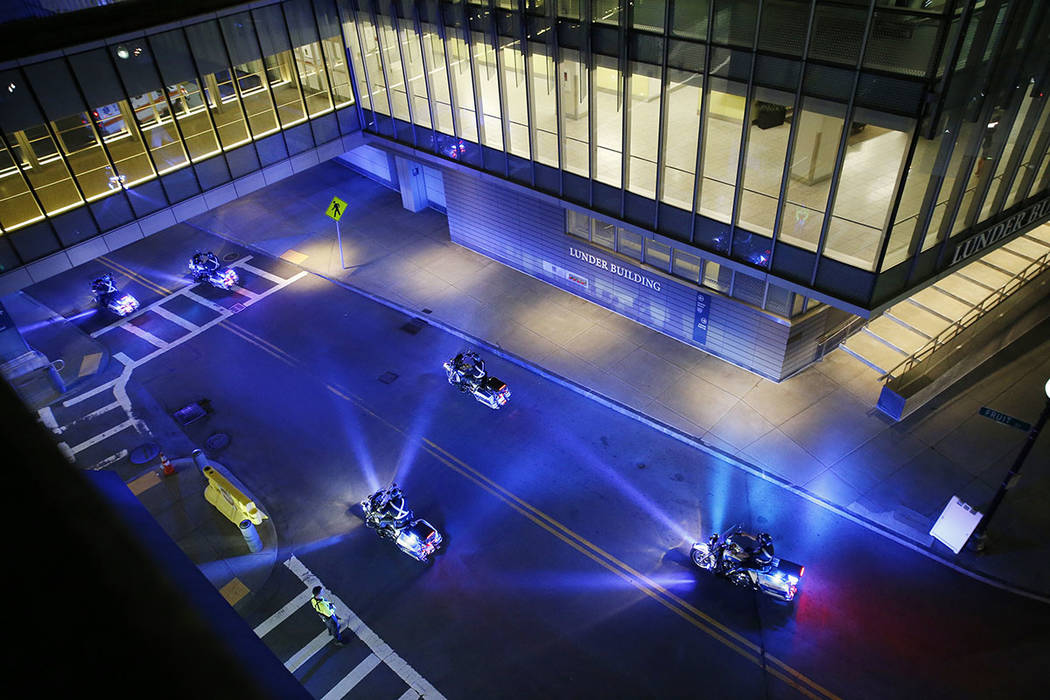 A police motorcade for the ambulance carrying David Ortiz arrives at Mass General Hospital in B ...