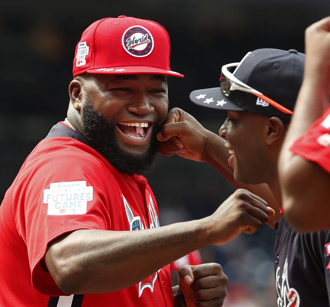 In this July 15, 2018, file photo, World Team Manager David Ortiz (34) speaks with U.S. Team Ma ...