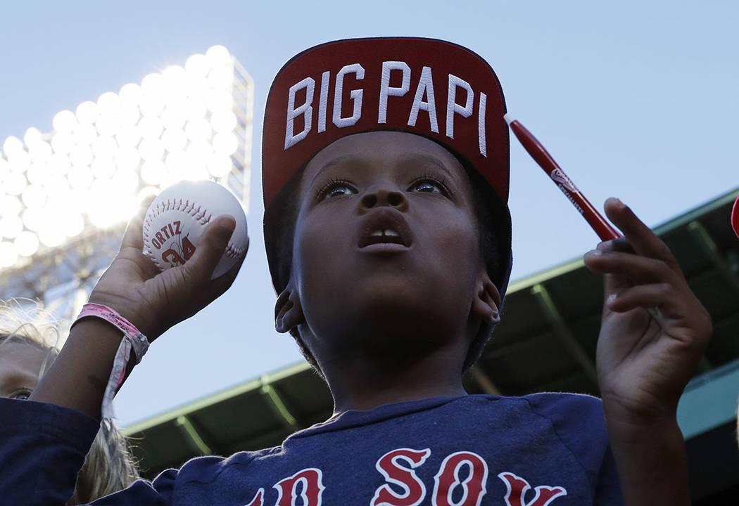 In this Aug. 29, 2016, file photo, a fan of Boston Red Sox designated hitter David Ortiz hopes ...