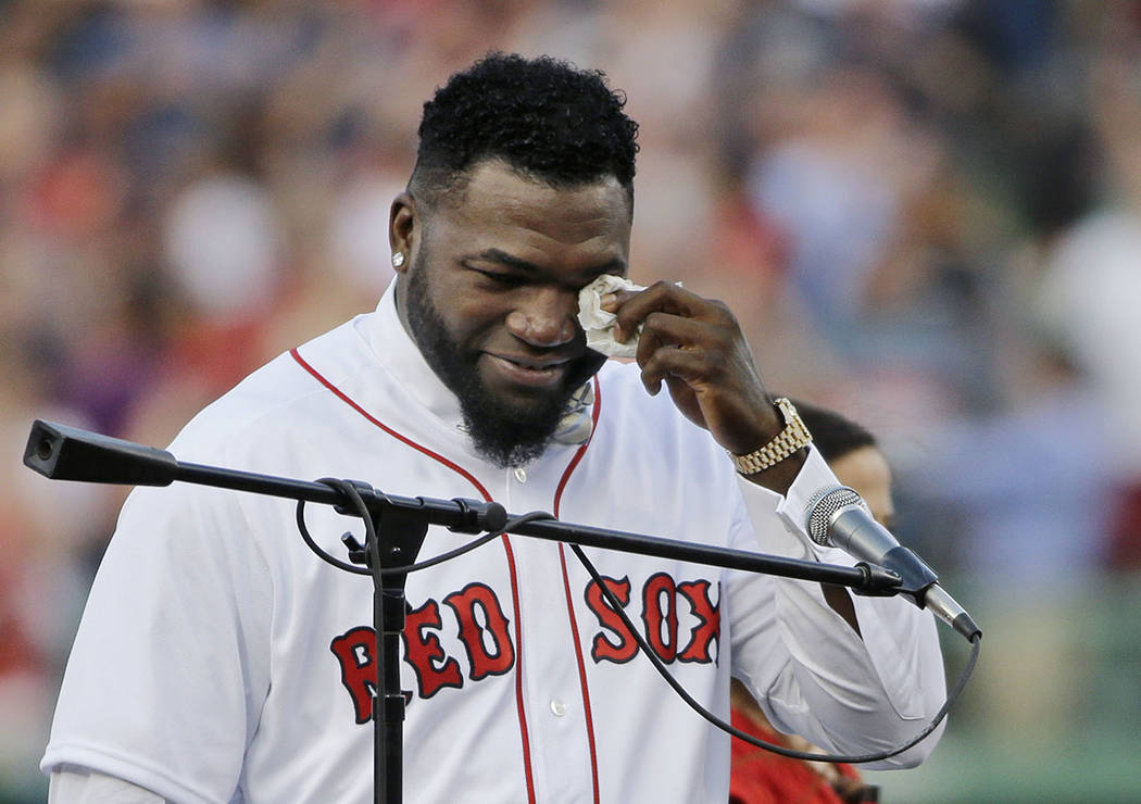 In this June 23, 2017, file photo, Boston Red Sox baseball great David Ortiz wipes a tear at Fe ...