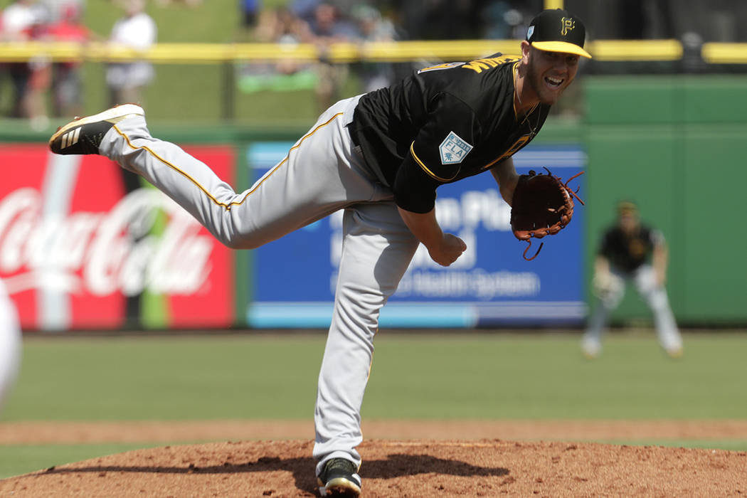 Pittsburgh Pirates starting pitcher Nick Kingham follows through on a delivery in the second in ...