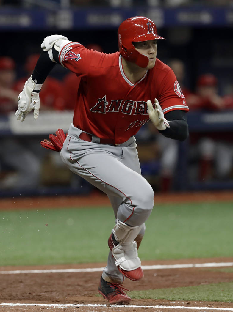 Los Angeles Angels' Shohei Ohtani, of Japan, runs to first with a triple off Tampa Bay Rays' Ry ...
