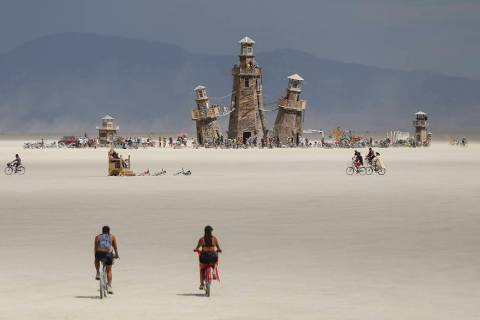 The Black Rock Lighthouse Service installation is shown in the distance during Burning Man at t ...