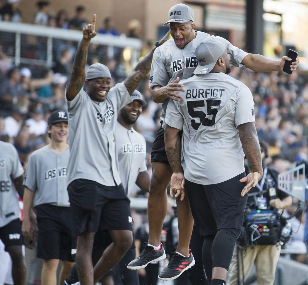 Oakland Raiders linebacker Vontaze Burfict, right, celebrates with Oakland Raiders safety Johna ...