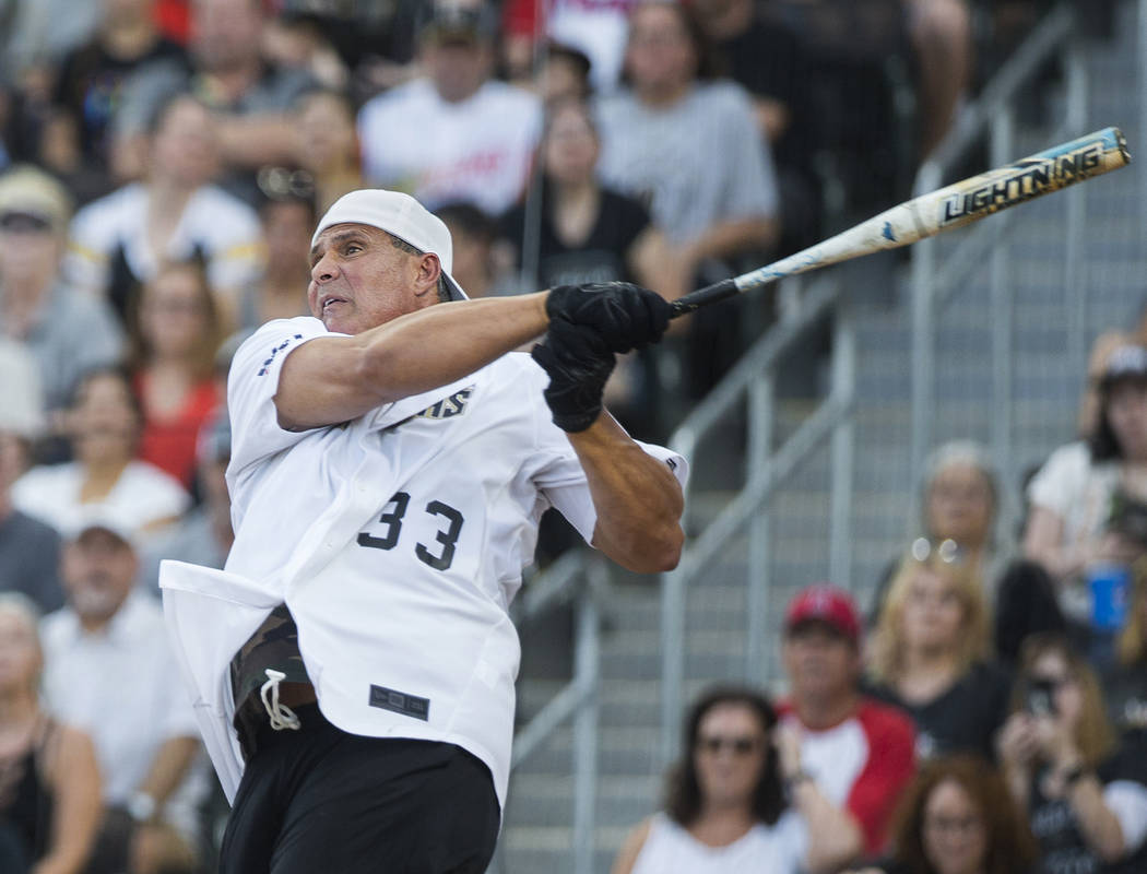 Former Major League Baseball player Jose Canseco takes a swing during the Battle For Vegas Char ...