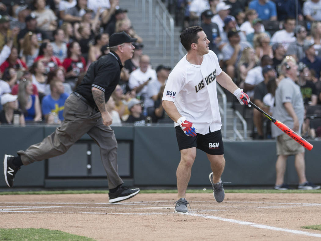 Golden Knights center Jonathan Marchessault, right, watches his ball sail over the left field w ...