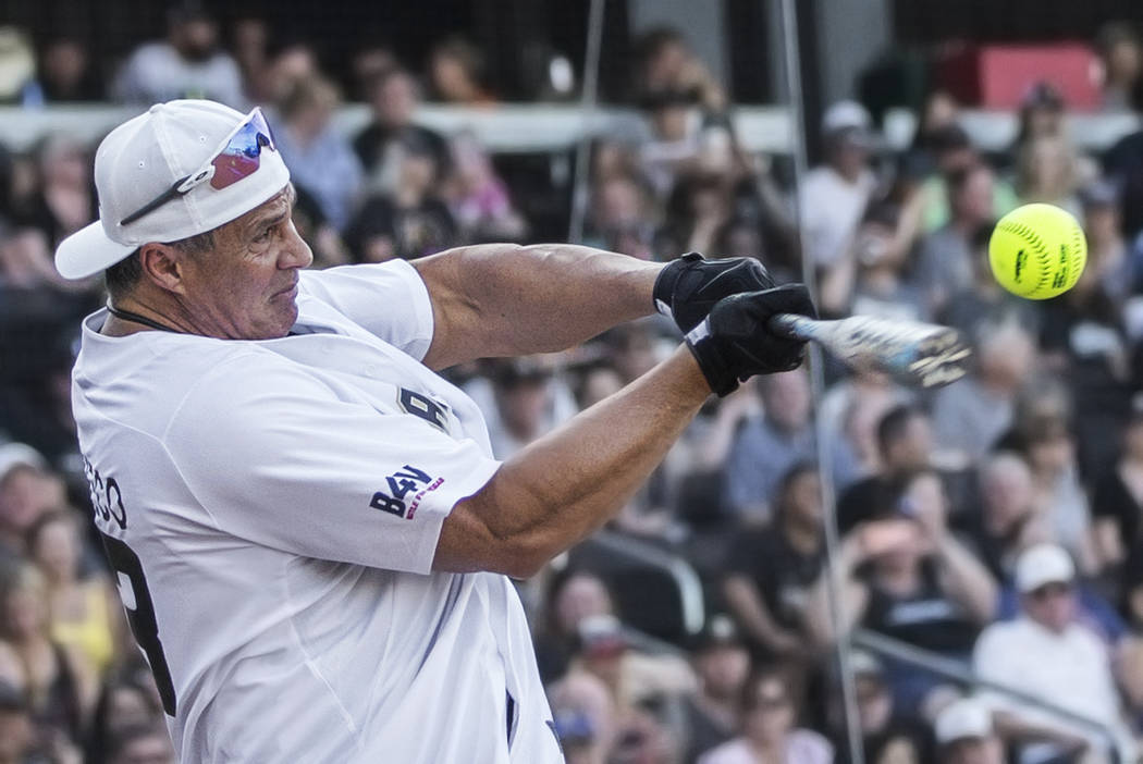 Former Major League Baseball player Jose Canseco takes a swing during the home run derby at the ...