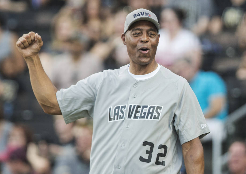 Former Oakland Raiders running back Marcus Allen fires up his team during the Battle For Vegas ...