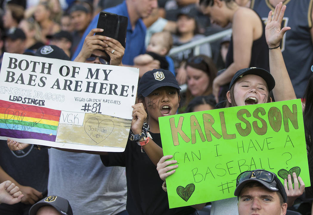 Ciarra Soto, right, and Teagan Barker cheer during the Battle For Vegas Charity Softball Game b ...