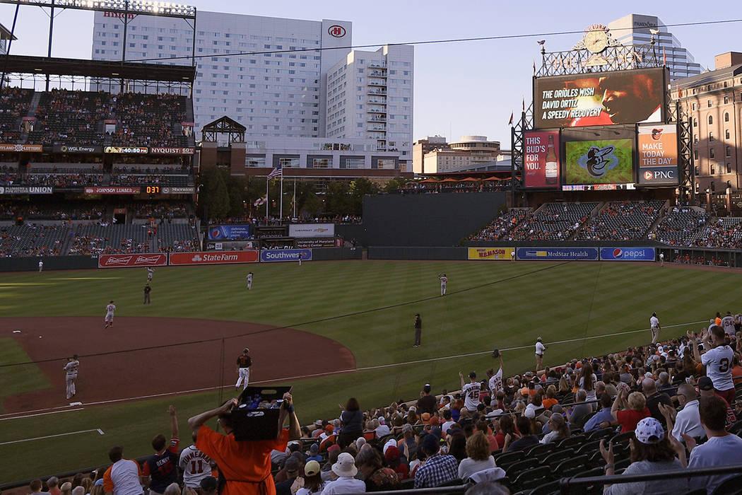 The center field scoreboard displays an image of Boston Red Sox great David Ortiz wishing him a ...
