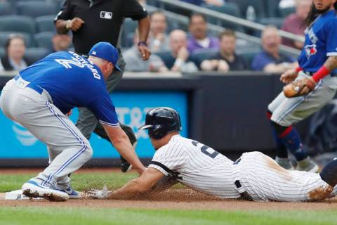 Toronto Blue Jays starting pitcher Clayton Richard, left, tags out New York Yankees' Giancarlo ...