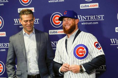 In this June 7, 2019, file photo, Chicago Cubs President Theo Epstein, left, introduces pitcher ...