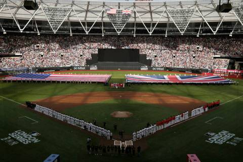 Boston Red Sox and New York Yankees players line up as flags are unfurled before a baseball gam ...