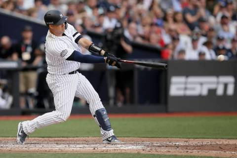 New York Yankees' Gary Sanchez hits a two-RBI single against the Boston Red Sox during the seve ...