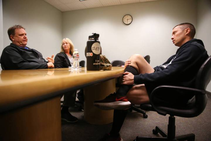 Chuck Reineck, from left, with his wife Jeanette, speaks to Chris Jachimiec during their suppor ...