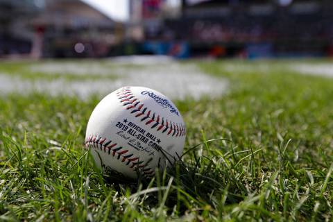 A baseball is pictured as the American League warms-up for the MLB baseball All-Star Game, Tues ...