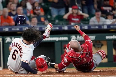 Houston Astros' Jake Marisnick, (6) collides Los Angeles Angels catcher Jonathan Lucroy (20) wh ...